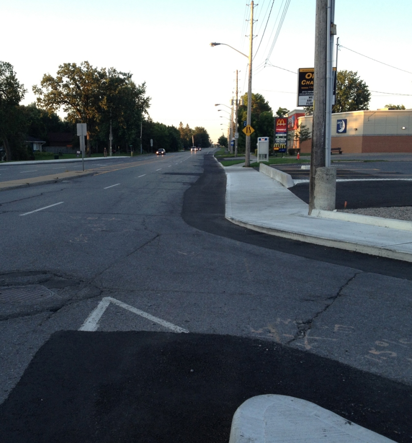 Fixed sidewalk at Hog's Back intersection