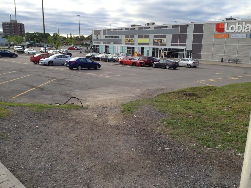 Well trodden desire line path to the Loblaw's parking lot.