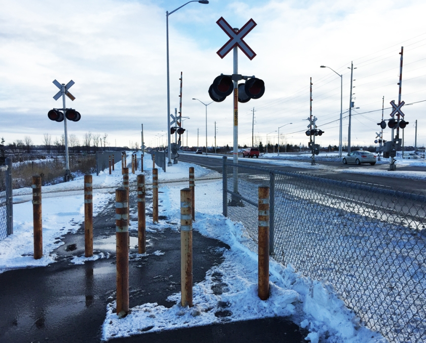 Crossing train tracks along Woodroffe