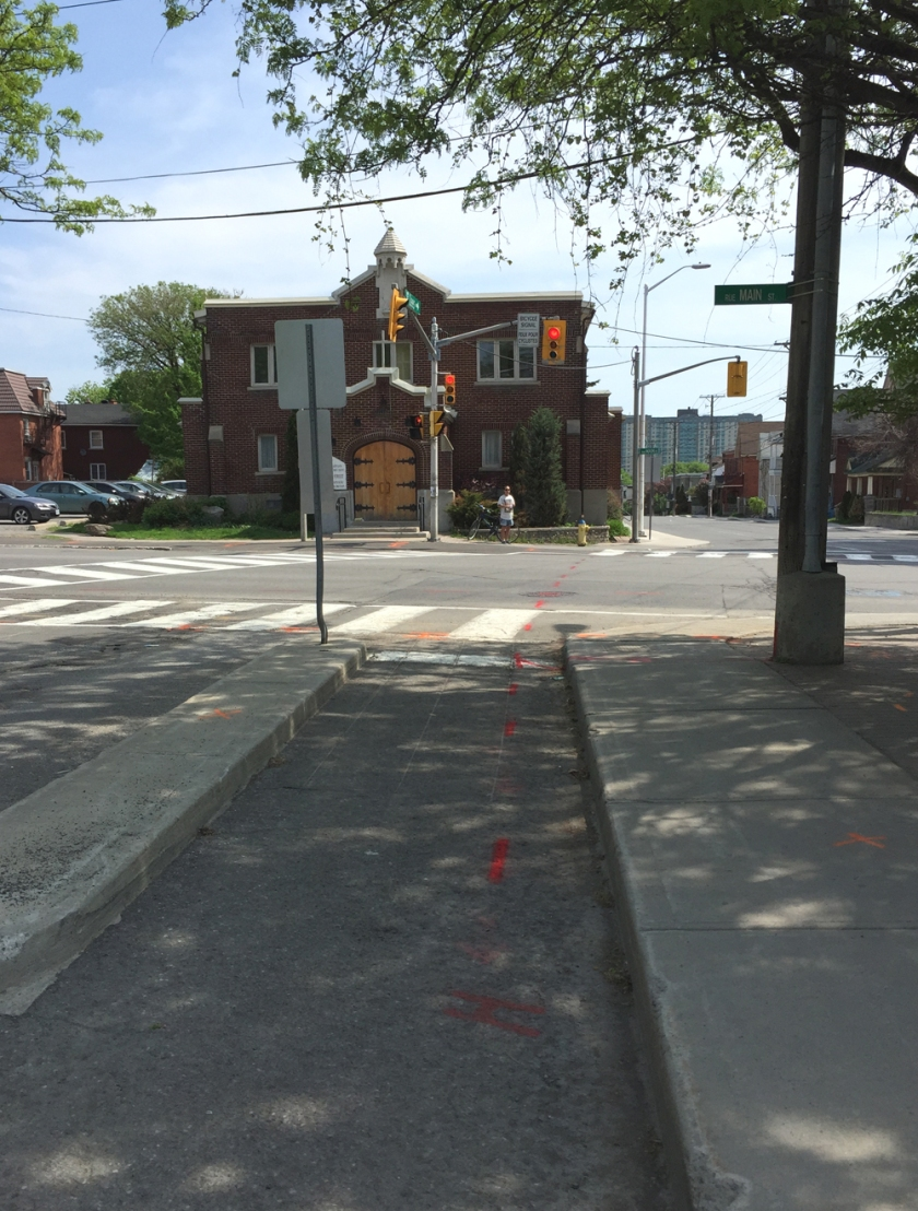 End of east bound bike lane along Graham, looking across Main St to Lees Ave