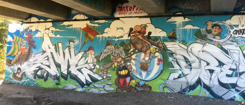 Graffiti under highway 5 to 50 interchanges along Ruisseau de la brasserie